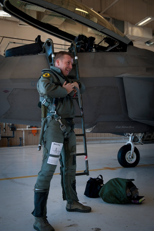 Lieutenant Colonel Shawn Anger, 7th Fighter Squadron commander, prepares to enter the cockpit of an F-22 Raptor at Holloman Air Force Base, N.M., Jan. 6. The first five of 24 combat-deployable F-22 Raptors left Holloman heading to Tyndall Air Force Base, Fla. as a permanent change of station. The five F-22s that left Jan. 6 will be followed by six Raptors leaving each month until the move is completed. (U.S. Air Force photo by Airman 1st Class Aaron Montoya)