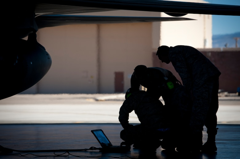 Airmen from the 49th Aircraft Maintenance Squadron perform pre-flight checks and preparations on an F-22 Raptor at Holloman Air Force Base, N.M., Jan. 6. The first five of 24 combat-deployable F-22 Raptors left Holloman heading to Tyndall Air Force Base, Fla. as a permanent change of station. The five F-22s that left Jan. 6 will be followed by six Raptors leaving each month until the move is completed. (U.S. Air Force photo by Airman 1st Class Aaron Montoya)