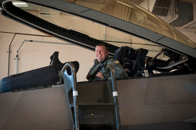 Lieutenant Colonel Shawn Anger, 7th Fighter Squadron commander, enters the cockpit of an F-22 Raptor at Holloman Air Force Base, N.M., Jan. 6. The first five of 24 combat-deployable F-22 Raptors left Holloman heading to Tyndall Air Force Base, Fla. as a permanent change of station. The five F-22s that left Jan. 6 will be followed by six Raptors leaving each month until the move is completed. (U.S. Air Force photo by Airman 1st Class Aaron Montoya)