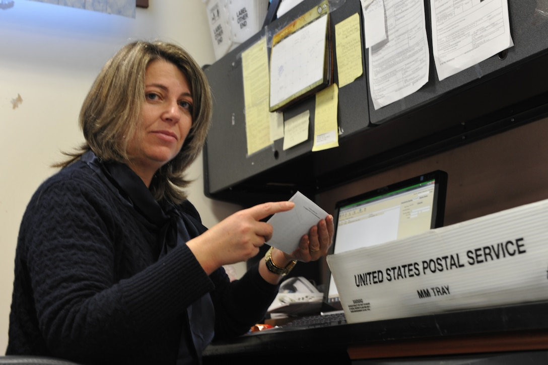Portuguese employee Paula Simoes, 65th Communications Squadron postal clerk, forwards and directs missent mail at the Lajes Field Post Office Jan. 9, 2014. The 65th CS Postal Service team was recently awarded the Information Dominance Air Force Outstanding Small Postal Facility Award for 2013. (U.S. Air Force photo by Staff Sgt. Angelique N. Smythe)
