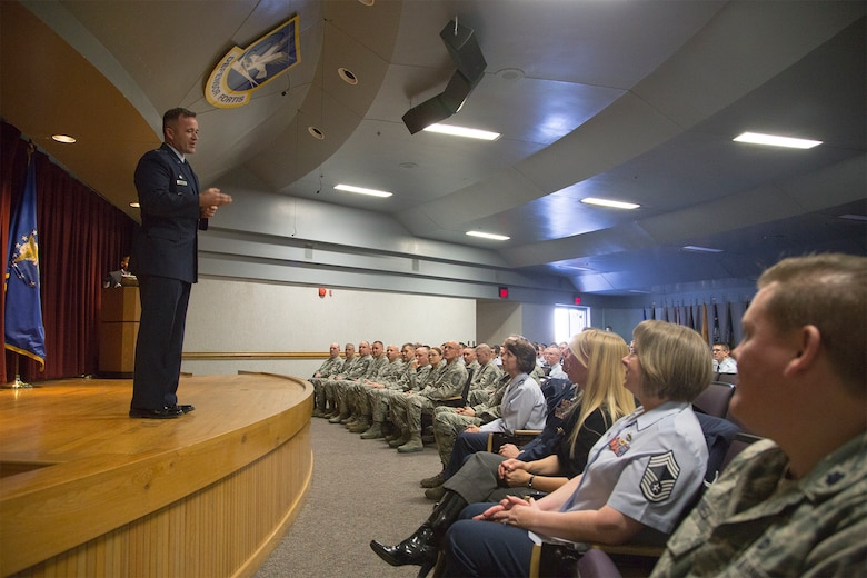Lt. Col. Paul Quigley, 343rd Traininag Squadron commander speaks about Staff Sgt. Todd Lobraico Jr., a defender who was killed in action in Afghanistan, during a dedication ceremony at the 343rd Training Squadron. The ceremony was held to honor Lobraico's sacrifice and add his photo to the Security Forces Memorial Wall.