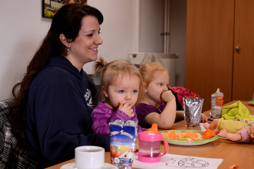 SPANGDAHLEM AIR BASE, Germany – Amy Crist sits with her two children, Audriana and Alayna, during a community coffee break at the 52nd Force Support Squadron Airman & Family Readiness Center Jan. 10, 2014. The coffee break allowed the opportunity to meet new people and talk about current events. (U.S. Air Force photo by Airman 1st Class Kyle Gese/Released)