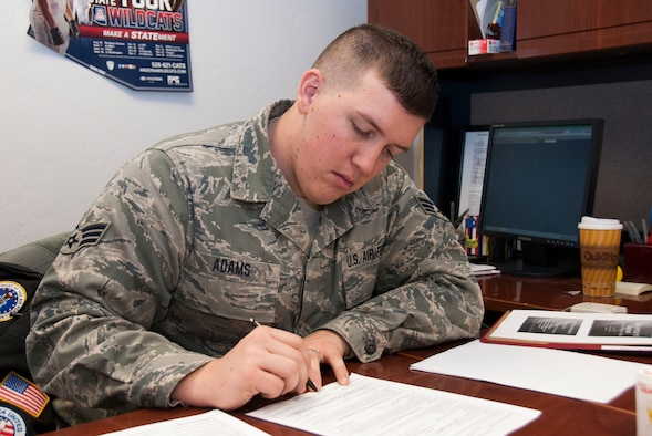 Senior Airman Bryan Adams, a paralegal specialist with the 162nd Fighter Wing's Judge Advocate General, reviews documents in the legal office. The JAG Corps here assists Air Guard personnel by meeting their pre-deployment legal needs while serving in a direct support function to the wing commander. Though JAG is not permitted to provide advice on criminal or certain civil matters, the 162nd Fighter Wing's legal support team highly encourages Airmen to visit their office so they can steer them in the right direction by providing referrals. (U.S. Air National Guard photo by Staff Sgt. Erich B. Smith/Released)