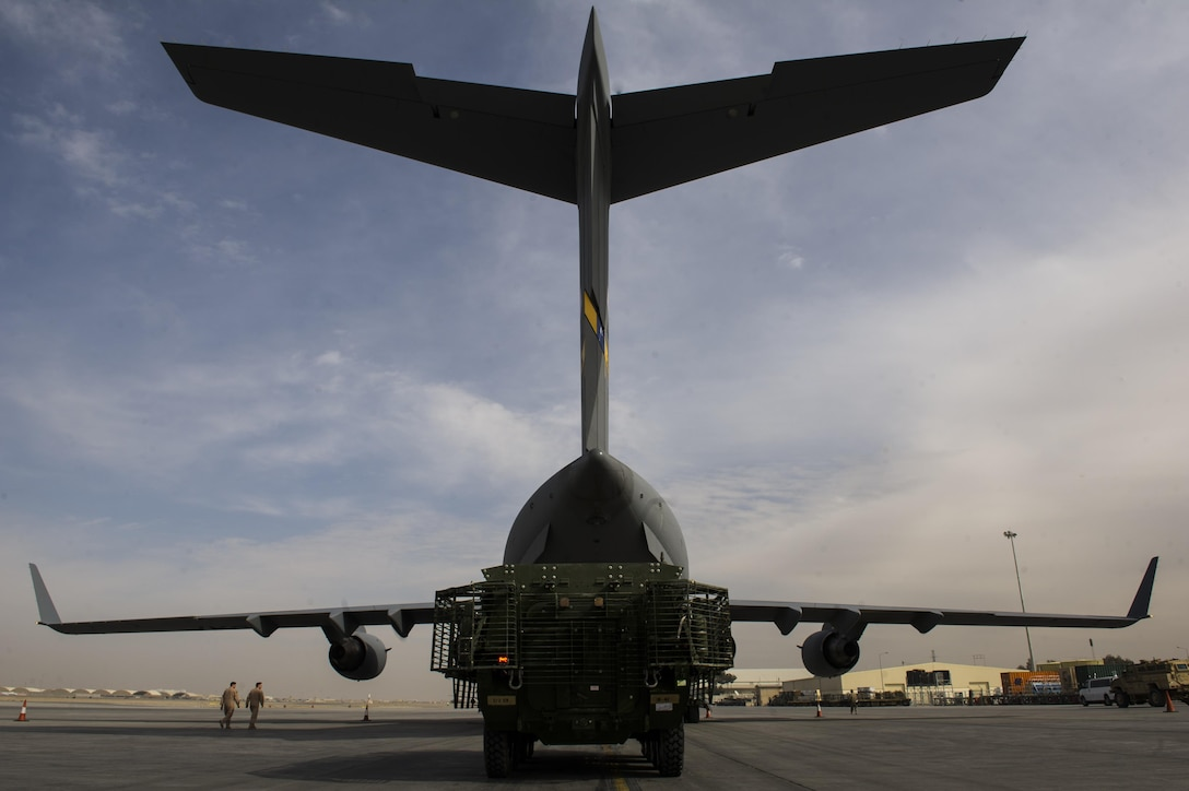 A C-17A Globemaster III with the 817th Expeditionary Airlift Squadron receives cargo at Kandahar Airfield, Afghanistan, Jan. 3, 2014. The C-17A is deployed from Joint Base Charleston, S.C., and is part of the 405th Air Expeditionary Group's mission while deployed. The 405th AEG supports U.S. Central Command's Deployment and Distribution Operation Center, a strategically located air, land and sea logistics hub, playing a critical role in the U.S. departure from Afghanistan. (U.S. Air Force photo by Staff Sgt. Stephany Richards)