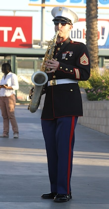 Staff Sgt. Kevin Oess, the assistant small assemble leader with Marine Band San Diego Party Band, plays his saxaphone during the fan fest before the Semper Fidelis All-American Bowl at The StubHub Center in Carson, Calif., Jan. 5, 2014. Local Marines from the reserve center and recruiting district set up vehicles and booths for the bowl attendees to learn more about the Marine Corps and be entertained before the start of the game. The Semper Fidelis Football Program brought together over 90 of the best high-school football players in an East versus West game and is an opportunity for the Marine Corps to connect on a personal and local level with players and influencers, demonstrates commitment to developing quality citizens, and reinforces how core values of honor, courage and commitment relate to success on and off the field. (Official U.S. Marine Corps photo by Sgt. Dwight A. Henderson/Released)