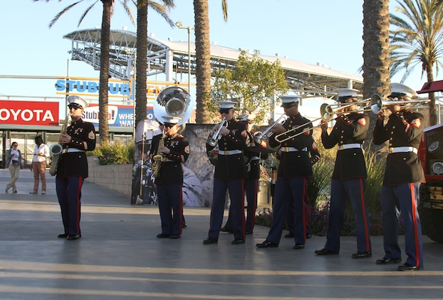 The Marine Band Sand Diego Party Band performs during the fan fest before the Semper Fidelis All-American Bowl at The StubHub Center in Carson, Calif., Jan. 5, 2014. Local Marines from the reserve center and recruiting district set up vehicles and booths for the bowl attendees to learn more about the Marine Corps and be entertained before the start of the game. The Semper Fidelis Football Program brought together over 90 of the best high-school football players in an East versus West game and is an opportunity for the Marine Corps to connect on a personal and local level with players and influencers, demonstrates commitment to developing quality citizens, and reinforces how core values of honor, courage and commitment relate to success on and off the field. (Official U.S. Marine Corps photo by Sgt. Dwight A. Henderson/Released)