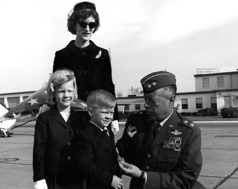 In November 1965 Maj. Gen. John Meyer presented the Air Force Cross on display to Capt. Jack Weatherby's widow, Barbara Weatherby, son Richard and daughter D'Ann. (U.S. Air Force photo)