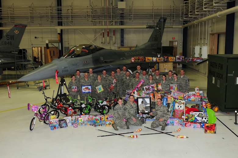 U.S. Air Force F-16C Fighting Falcon crew chiefs and other members of the 148th Fighter Wing display the children's toys that were purchased as the result of the Inaugural Ryan Ewald Memorial Toy Drive, December 16, 2013.  The Wing wide Toy Drive raised over 3,000 dollars which was used to purchase toys that were donated to local charities in the Duluth, Minn. area.  (U.S. Air National Guard photo by Master Sgt. Ralph J. Kapustka/Released)