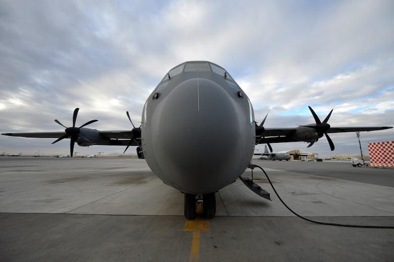 A C-130J Super Hercules sits on the flight line awaiting departure at Kandahar Airfield, Afghanistan, Jan. 12, 2013. The C-130J Super Hercules will take over for the C-130 Hercules at Bagram Airfield, after four months at Kandahar. (U.S. Air Force photo by Senior Airman Kayla Newman/Released)