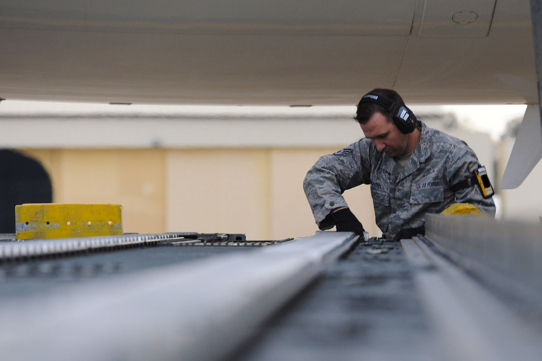 Staff Sgt. William Mangin, 728th Air Mobility Squadron aircraft services load team chief, prepares a 60k loader to download cargo boxes from a French air force Airbus A310 Jan. 9, 2014, at Incirlik Air Base, Turkey. The French air force provided personnel and cargo airlift to the German military as they deployed troops to Turkey where they will assume responsibility for manning two Patriot missile batteries as part of a NATO mission to increase Turkey's air defense capabilities against Syrian ballistic missile threats. (U.S. Air Force photo illustration by 1st Lt. David Liapis/Released)