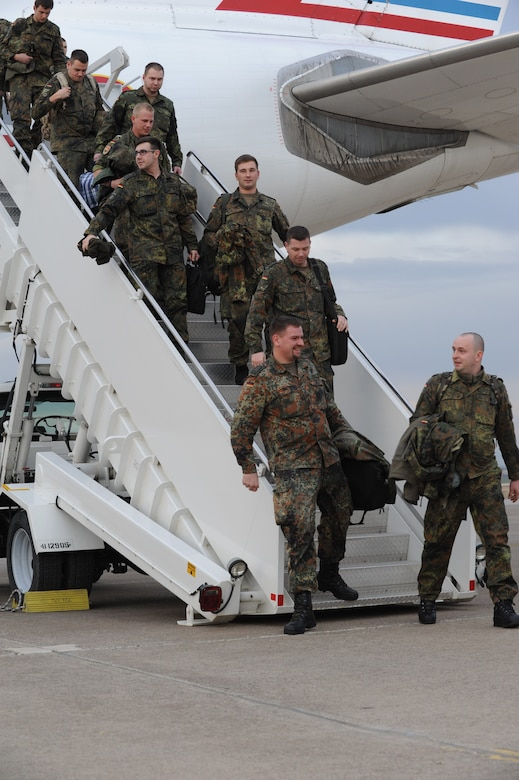 German soldiers disembark from a French air force Airbus A310 that arrived Jan. 9, 2014, at Incirlik Air Base, Turkey. The German government recently approved a year-long extension for German support of the ongoing NATO mission to increase Turkey's air defense capabilities against Syrian ballistic missile threats. The arriving personnel will relieve deployed soldiers currently manning two Patriot missile batteries in Kahramanmaras, Turkey. (U.S. Air Force photo by 1st Lt. David Liapis/Released)