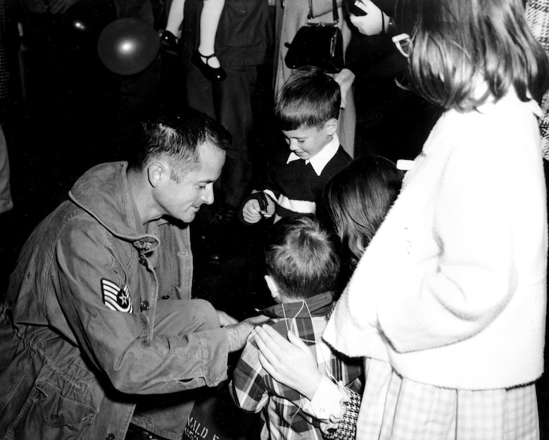 A Colorado Guardsman greets his family upon returning from South Vietnam. About 10,600 Air National Guardsmen were mobilized in 1968 -- 2,000 went to Southeast Asia (with seven killed in action), and another 4,000 served in South Korea or Japan. (U.S. Air Force Photo)
