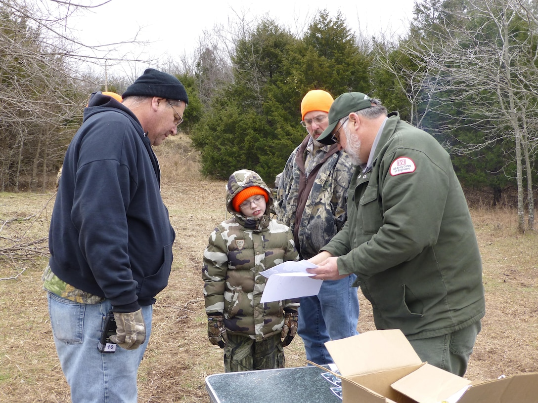 Supervisory Biologist, Bruce Caldwell, gives young hunters and their escorts directions to their hunting blind.
