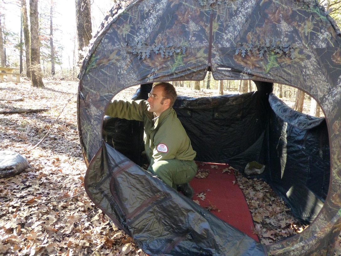 Natural Resources Specialist, Ty Fowler, setting up blinds for the Ozark Isle Youth Deer Hunt.