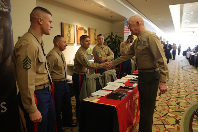 Prior-service recruiters shake hands with Lt. Gen. Richard P. Mills, the commander of Marine Forces Reserve and Marine Forces North, during the annual IRR Mega-Muster in Fort Worth, Texas, Jan. 11, 2014. Prior-Service Recruiters were there to talk with Marines about opportunites they have and benefits of re-enlisting. The annual mega-muster is sponsored by the Marine Corps Individual Reserve Support Activity, Marine Forces Reserve. The muster gives IRR Marines an opportunity to update personal information, get information on education and job opportunites, and go through medical screening. (Official photo by Lance Cpl. Brytani Musick)