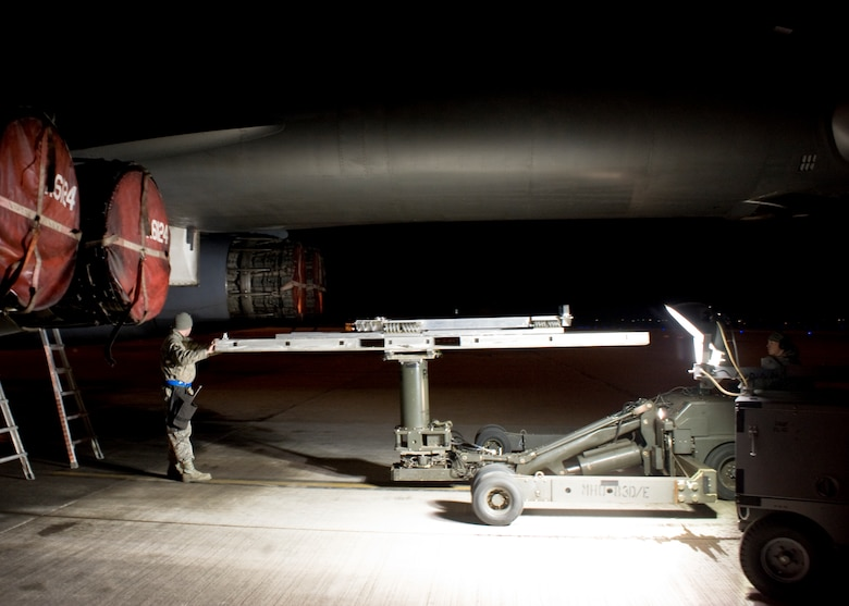 U.S. Air Force Staff Sgt. Charles Taylor, 7th Aircraft Maintenance Squadron, positions a munitions lift truck under the aft munitions bay to remove a Joint Air-to-Surface Standoff Missile-Extended Range missile from a B-1B Lancer Dec. 12, 2013, at Dyess Air Force Base, Texas. The JASSM-ER is an autonomous, long-range, air-to-ground, precision missile used solely by the B-1B Lancer. The JASSM-ER's significant standoff range is designed to keep aircrew out of danger from hostile air defense systems. (U.S. Air Force photo by Senior Airmen Peter Thompson/Released)