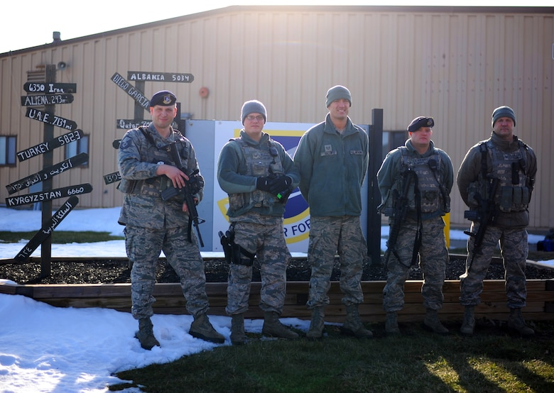 Airmen from the 180th Fighter Wing Security Forces Squadron, Ohio Air National Guard, teamed up with the Swanton Lions Club to deliver gifts to children this holiday season. The 180th FW is dedicated to continuing the long-standing tradition of giving back to those communities who support the wing. Pictured from left to right; Master Sgt. Scott Batch, Staff Sgt. Cody McLuckie, Tech. Sgt. Russell Bacon, Staff Sgt. Marc Robertson and Tech. Sgt. Jeff Carr. (Ohio Air National Guard photo by Staff Sgt. Amber Williams/Released)