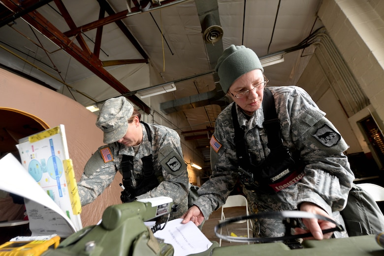 U.S. Army Staff Sgt. Dalene Link (left), 82nd Civil Support Team decontamination NCO in charge, and U.S. Army Sgt. 1st Class Marcia Hento, 82nd CST NCO in charge of supply, setup a decontamination area during a training exercise at Ellsworth Air Force Base, S.D., Jan. 8, 2014. The 82nd CST team consists of 22 individuals who are trained to assist authorities in response to chemical, biological, radiological, nuclear and explosive threats. (U.S. Air Force photo by Senior Airman Zachary Hada/Released)