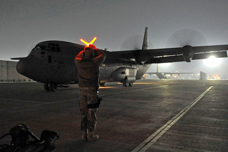 The final C-130J Super Hercules to relocate to Bagram Airfield, Afghanistan, is marshalled to a stop on the ramp, Jan. 12, 2013. The Super Hercules models permanently replaced the recently departed fleet of C-130H Hercules aircraft at Bagram.(U.S. Air Force photo by Senior Master Sgt. Gary J. Rihn/Released)