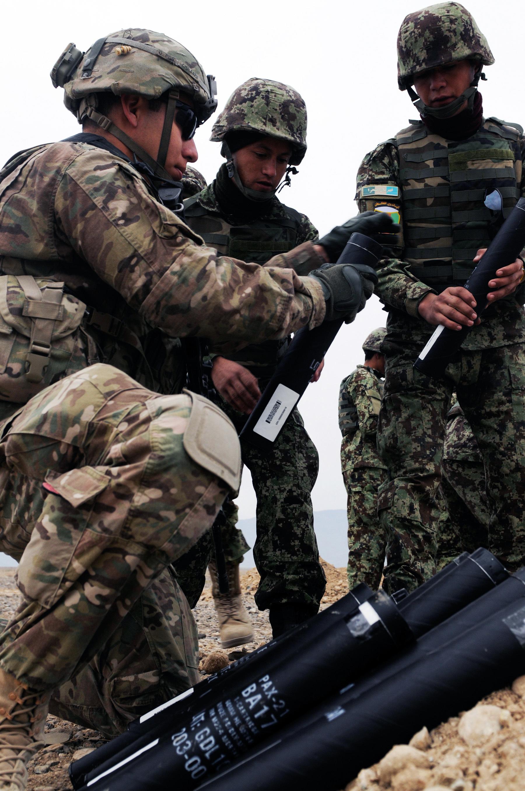 U S  Army Spc  Anthony Barajas helps Afghan soldiers prepare