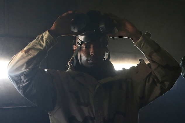 Corporal Cavin S. Sanders, a chemical, biological, radiological and nuclear defense specialist with Headquarters Company, Combat Logistics Regiment 17, 1st Marine Logistics Group, breaks the seal on his M50 gas mask as part of a course designed to instruct Marines on how to defend against CBRN threats aboard Camp Pendleton, Calif., Jan. 6, 2014 Marines received training on conducting reconnaissance and identifying potential CBRN threats, operating equipment designed to protect personnel from chemical threats, and decontamination to ensure they take necessary steps to ensure Marines do not become casualties. Sanders is a native of Miami.