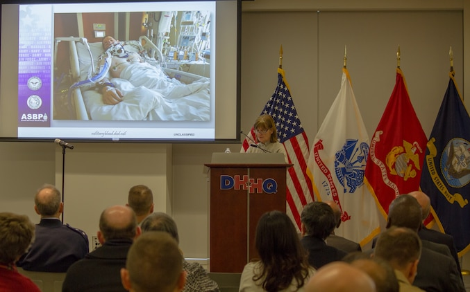 Ms. Stacy Fidler, mother of a wounded warrior, shares her son's story with attendees of the second annual National Blood Donor Month celebration held Jan. 9 at the Defense Health Headquarters.