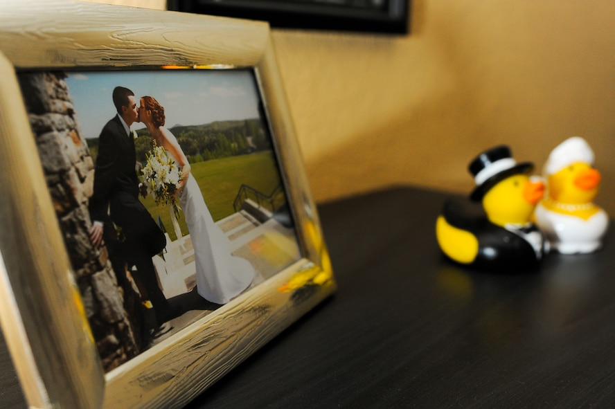 SPANGDAHLEM AIR BASE, Germany – A wedding photo is openly displayed in the Bigler home Jan. 13, 2014. U.S. Air Force Staff Sgt. Tyler Bigler deployed with the 606th Air Control Squadron in July 2013 in support of Operation Enduring Freedom. (U.S. Air Force photo by Senior Airman Rusty Frank/Released)