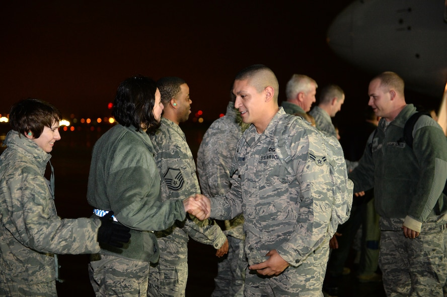 """SPANGDAHLEM AIR BASE, Germany – Airmen from the 606th Air Control Squadron shake hands with Spangdahlem leadership after returning from a deployment to Southwest Asia Jan. 15, 2014. The 606th ACS, known as the """"Inspectors of the Skies,"""" originally activated Dec. 15, 1945, as the 606th Tactical Control Squadron. (U.S. Air Force photo by Senior Airman Alexis Siekert/Released)"""