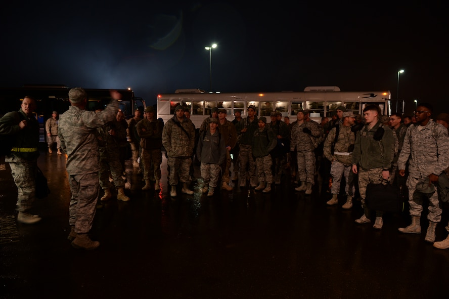 SPANGDAHLEM AIR BASE, Germany – U.S. Air Force Airmen receive a briefing before seeing their families Jan. 15, 2014. Members of the 606th ACS departed for Southwest Asia July 10, 2013, to provide air defense of the Arabian Gulf in support of Operation Enduring Freedom. (U.S. Air Force photo by Staff Sgt. Daryl Knee/Released)