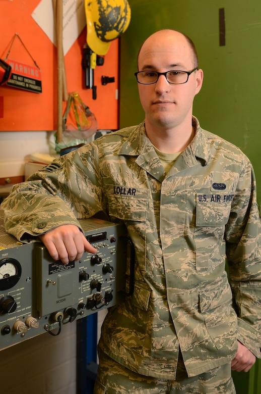 SPANGDAHLEM AIR BASE, Germany -- U.S. Air Force Senior Airman Alex Lollar, 606th Air Control Squadron radio frequencies transmissions technician from Pensacola, Fla., stands in front of his equipment Jan. 15, 2014. The 606th ACS recently deployed in support of Operation Enduring Freedom. Lollar supported the deployed members of the 606th ACS from Spangdahlem AB. (U.S. Air Force photo by Airman 1st Class Kyle Gese/Released)