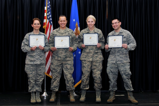 From left: Senior Airman Becky Bagley, 130th Engineering Installation Squadron; Senior Airman Tammy Annis, 151st Force Support Squadron; Senior Airman Jennelle Lewis, 151st Medical Group; and Senior Airman Jesse Betts, 151st Logistics Readiness, graduated from the Airman Leadership School at Hill Air Force Base, on December 20, 2013. (Utah National Guard Photo by SSgt Annie Edwards/released)
