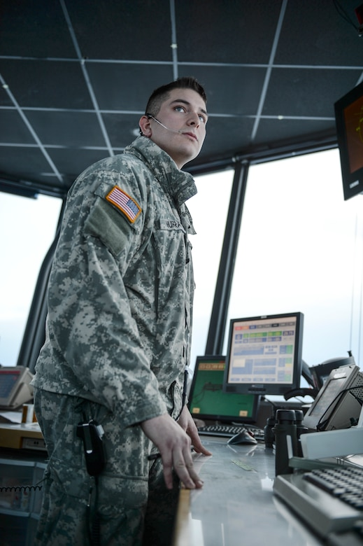 U.S. Army Spc. Paul Murray, Fox Company 1-52, Aviation Battalion, air traffic control specialist, watches the flight line for incoming aircraft Dec. 20, 2013, Eielson Air Force Base, Alaska. Murray is training with Air Force air traffic controllers to prepare for an upcoming deployment in which he will guide and direct primarily fixed-wing aircraft. (U.S. Air Force photo by Senior Airman Shawn Nickel/Released)