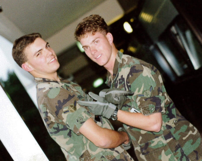 Then, Airman Jeffrey Woolford poses with a fellow Airman at his first duty station Ramstein Air Base, Germany. Maj. (Dr.) Woolford enlisted in the Air Force as an aircraft maintenance crew chief in 1989, and commissioned as an A-10 Thunderbolt II pilot in 1998. Woolford realized he wanted to become a pilot while assigned to Ramstein. (U.S. Air Force courtesy photo)
