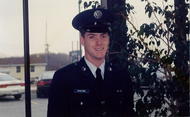 Then, Airman Jeffrey Woolford, a crew chief, poses for a photo in his dress uniform shortly after graduating U.S. Air Force Basic Military Training. Maj. (Dr.) Woolford enlisted in the Air Force as an aircraft maintenance crew chief in 1989, and commissioned as an A-10 Thunderbolt II pilot in 1998. (U.S. Air Force courtesy photo)