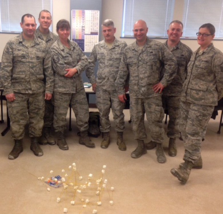 SCOTIA, N.Y. -- Air National Guardsmen constructed a tower made of spaghetti and marshmallows during a team building exercise Jan. 11 at the 109th Airlift Wing's first Leadership Development Course. The three-day course, held by the 109th AW chief's council at the Naval Operations Support Center Jan. 10-12, 2014, covered topics including Profession of Arms, performance review writing, time management and career management. (Air National Guard photo by Chief Master Sgt. Mary Alice Rebis/Released)