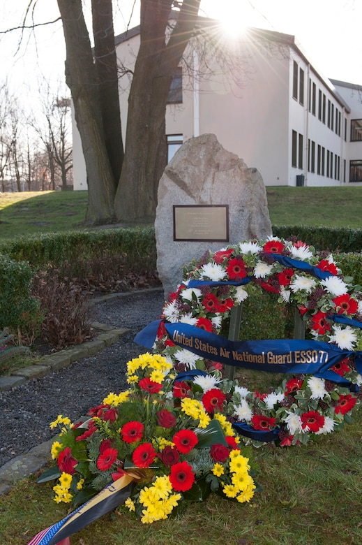 "A memorial stone sits on base at Geilienkirchen Air Base, Germany, Jan. 10, 2014 in remembrance of the crash of a 141st Air Refueling Wing, Fairchild Air Force Base KC-135E Stratotanker. The memorial was erected for ""ESSO 77"" crew members: Maj. David Fite, Maj. Mattew Laiho, Capt. Kenneth Thiele and Tech. Sgt. Richard Visintainer who perished in the crash Jan. 13, 1999.(NATO E-3A component Photo By  Mr. Andre Joosten/Released)"