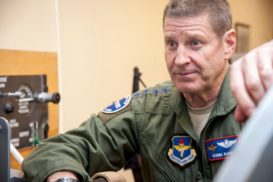 """Gen. Robin Rand, Air Education and Training Command commander, inspects a T-38 Talon cockpit mock-up at Laughlin Air Force Base, Texas, Jan. 9, 2014. """"I've been watching your base for a long time, and it's amazing what I see here,"""" said Rand during a briefing at Laughlin. """"Your mission at Laughlin is the pulse, the bread and butter of the Air Force, and I hope you know that."""" (U.S. Air Force photo/Senior Airman John D. Partlow)"""