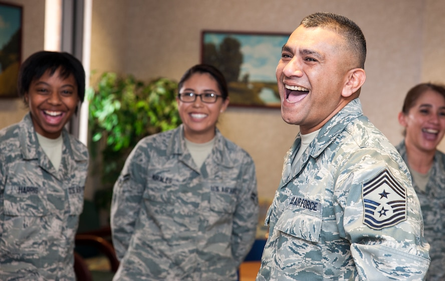 Chief Master Sgt. Gerardo Tapia, Air Education and Training Command command chief, shares a laugh with the 47th Medical Group at the base clinic on Laughlin Air Force Base, Texas, Jan. 9, 2014. The clinic's team members spoke to him about how they train and maintain standards, supporting mission readiness. (U.S. Air Force photo/Airman 1st Class Jimmie D. Pike)