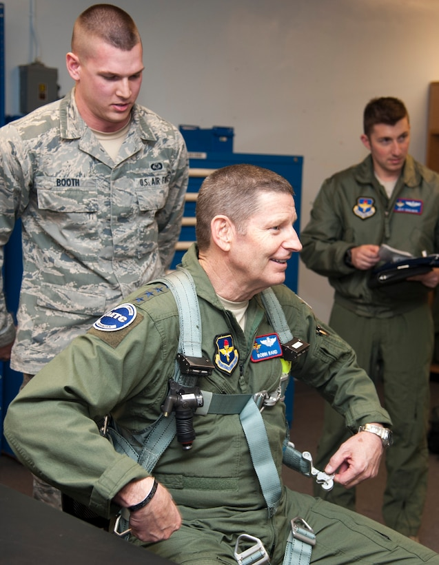 Gen. Robin Rand, Air Education and Training Command commander, unlatches a harness after getting fitted by Aircrew Flight Equipment at Laughlin Air Force Base, Texas, Jan. 8, 2014. He was fitted in a harness for a training sortie scheduled during his visit. (U.S. Air Force photo/Airman 1st Class Jimmie D. Pike)