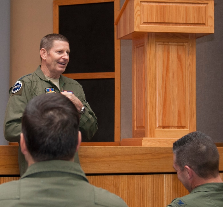 Gen. Robin Rand, Air Education and Training Command commander, briefs Laughlin senior non-commissioned officers about force reshaping at Anderson Hall on Laughlin Air Force Base, Texas, Jan. 8, 2014. During his visit he spoke to airmen and answered any questions about force reshaping. (U.S. Air Force photo/Airman 1st Class Jimmie D. Pike)