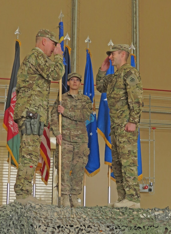U.S. Air Force Brig. Gen. Patrick Malackowski, 455th Air Expeditionary Wing commander, salutes Col. Scott Campbell, 451st Air Expeditionary Group commander, in a transition ceremony at Kandahar Airfield, Afghanistan, Jan. 13, 2014. The 451st Air Expeditionary Wing was transitioned to an AEG due to a change in mission.(U.S. Air Force photo by Senior Airman Alexandria Bandin/Released)