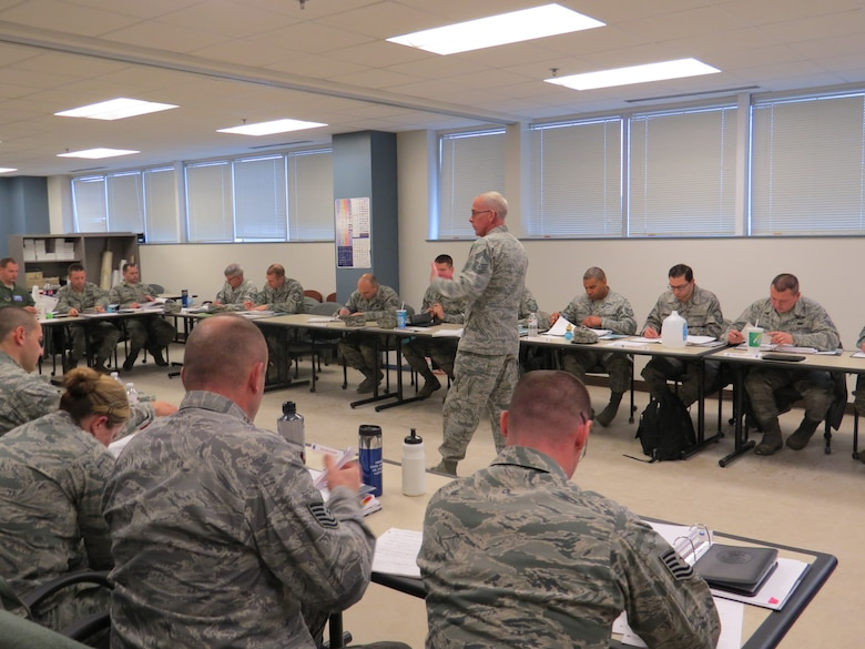 SCOTIA, N.Y. -- Chief Master Sgt. Mark Schaible instructs a portion of the 109th Airlift Wing's first Leadership Development Course at the Naval Operations Support Center on Jan. 12, 2014. The three-day course, held by the 109th AW chief's council, covered topics including Profession of Arms, performance review writing, time management and career management. (Air National Guard photo by Chief Master Sgt. Michelle Shafer/Released)