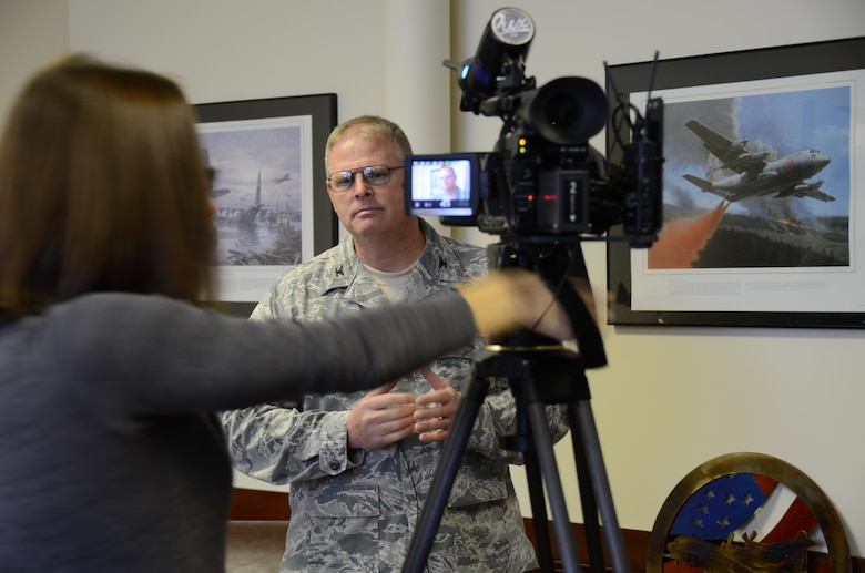 U.S. Air Force Col. Marshall C. Collins, 145th Maintenance Group commander, talks with reporter Kate Gaier, during an interview held at the North Carolina Air National Guard base, Charlotte Intl. airport, January 14, 2014.  Collins described the rewards of supporting the 145th Operations Group and Charles D. Davis III who once again, will command the national military mission charged with combating wildland forest fires known as the Modular Airborne Fire Fighting System. 145th MXS, behind-the-scene maintainers, prepare C-130 aircraft that carry MAFFS, to mission readiness.  These aircrafts serve as aerial tankers to extinguish forest fires supporting the U.S. Forest Service during the firefighting season.  (Air National Guard photo by Master Sgt. Patricia F. Moran, 145th Airlift Wing Public Affairs/Released)