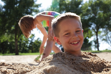 Kids enjoy the cool sand at Lucky Peak State Park's Sandy Point Unit.