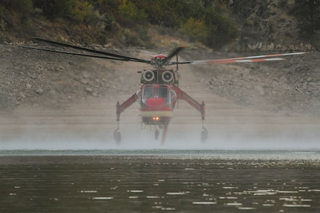 Fire hazards soar every summer around Lucky Peak Lake.  The Corps of Engineers and allied agencies work closely together to facilitate safe helicopter dipping operations from the lake to assist nearby firefights.