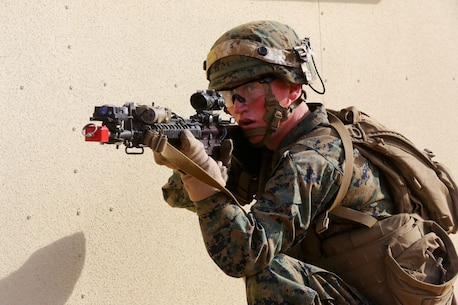 Lance Cpl. Hayden Parker, rifleman, Alpha Company, 1st Battalion, 5th Marine Regiment, and a native of Florence, Ariz., provides security for his fire team during an Urban Operations exercise at Marine Corps Base Camp Pendleton, Calif., Jan. 9, 2014. The training area tested the Marines' knowledge and skills on operations in austere conditions. The range portrayed how an urban battlefield may look in a combat environment. (U.S. Marine Corps photo by Lance Cpl. Christopher J. Moore/Released)