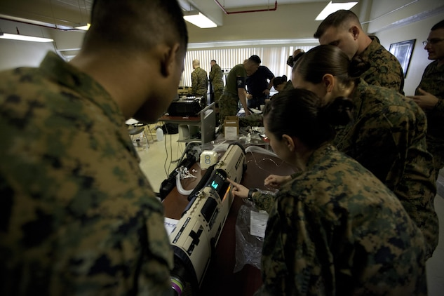 Naval medical personnel execute the startup process of the mobile, oxygen, ventilation and external suction system Jan. 7 at Camp Kinser. The sailors are with 3rd Medical Battalion, 3rd Marine Logistics Group, III Marine Expeditionary Force.