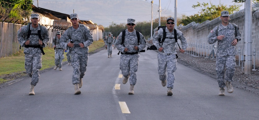 Members of Joint Task Force-Bravo participate in a road march as part of the German Armed Forces Proficiency Badge Qualification test at Soto Cano Air Base, Honduras, Jan. 14, 2014.  Forty members of Joint Task Force-Bravo earned the badge over three days of testing.  (U.S. Air Force photo by Capt. Zach Anderson)