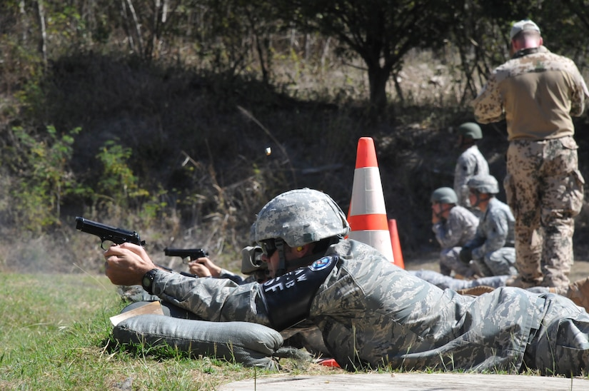Members of Joint Task Force-Bravo fire M9 pistols at targets 25 meters away as part of the German Armed Forces Proficiency Badge Qualification test at Soto Cano Air Base, Honduras, Jan. 14, 2014.  Forty members of Joint Task Force-Bravo earned the badge over three days of testing.  (Photo by Ana Fonseca)