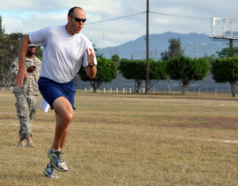 U.S. Air Force Maj. Robert Shaw, Commander of Joint Task Force-Bravo's Joint Security Forces, participates in the 11x10 meter spring test as part of the German Armed Forces Proficiency Badge Qualification test at Soto Cano Air Base, Honduras, Jan. 14, 2014.  Forty members of Joint Task Force-Bravo earned the badge over three days of testing.  (U.S. Air Force photo by Capt. Zach Anderson)